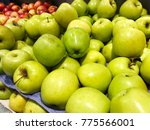 red and green apples in the... | Shutterstock . vector #775566001