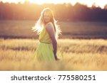 blonde girl standing in the... | Shutterstock . vector #775580251