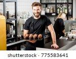 portrait of a handsome bearded... | Shutterstock . vector #775583641