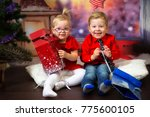 boy and girl twins posing in... | Shutterstock . vector #775600105