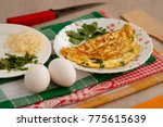 omelette from eggs  cheese and... | Shutterstock . vector #775615639