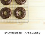 chocolate donuts on wooden... | Shutterstock . vector #775626559