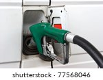 Commercial vehicle is being filled up with fuel. - stock photo