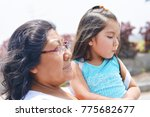 sad latin woman with her little ...   Shutterstock . vector #775682677