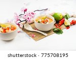 traditional tom yum soup with... | Shutterstock . vector #775708195