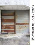 Small photo of Shutter doors used for garage. It has deteriorated and rusted.