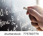 teacher writing to blackboard... | Shutterstock . vector #775783774