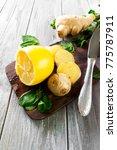 ginger sliced  lemon and mint... | Shutterstock . vector #775787911