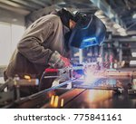 one man welding steel... | Shutterstock . vector #775841161
