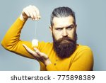 handsome bearded man with long... | Shutterstock . vector #775898389