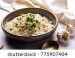garlic fried rice or pulav... | Shutterstock . vector #775907404