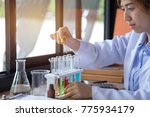 young asian scientist using...   Shutterstock . vector #775934179