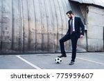 smiling businessman in suit... | Shutterstock . vector #775959607