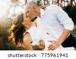 happy couple are walking... | Shutterstock . vector #775961941