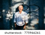 young man in white shirt on the ... | Shutterstock . vector #775966261