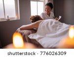 beautician examining female... | Shutterstock . vector #776026309