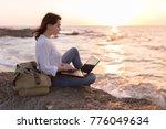 freelancer girl working on the... | Shutterstock . vector #776049634