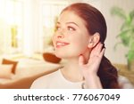 a girl with a hearing aid. the... | Shutterstock . vector #776067049