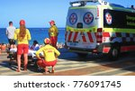 Small photo of Coogee Beach, Sydney, Australia - 15 December 2017: Surf Rescue Life Guards alongside Ambulance Paramedics with a stretcher on emergency call to treat an injured member of the public. 15/12/2017.