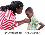 young woman dressing her child... | Shutterstock . vector #776093464