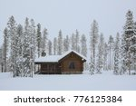 Log Cabin In The Snow During A...