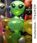 Small photo of Bright colored alien doll