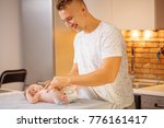 young father is changing diaper ... | Shutterstock . vector #776161417