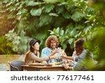 group of joyful friends... | Shutterstock . vector #776177461