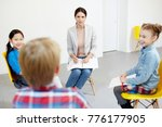 young teacher and two little... | Shutterstock . vector #776177905