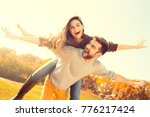 young couple walk in the autumn ... | Shutterstock . vector #776217424