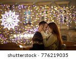 young couple stands embracing...   Shutterstock . vector #776219035