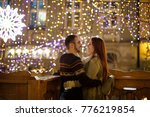 young couple stands embracing... | Shutterstock . vector #776219854
