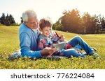 grandfather and grandson... | Shutterstock . vector #776224084