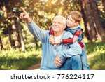 grandfather and grandson... | Shutterstock . vector #776224117
