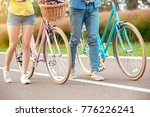 couple riding bicycle together... | Shutterstock . vector #776226241