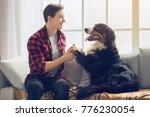 young person with dog at home... | Shutterstock . vector #776230054
