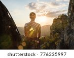climber meditating on the top... | Shutterstock . vector #776235997