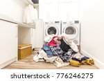 laudry room with a pile of... | Shutterstock . vector #776246275