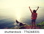 young woman with raised hands... | Shutterstock . vector #776268331