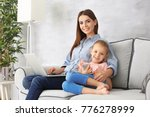 busy young woman with daughter... | Shutterstock . vector #776278999