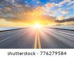 Empty Asphalt Highway And Blue...
