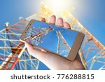 a smartphone in the hand... | Shutterstock . vector #776288815