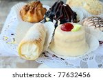 several kinds of cakes on a special stand dessert plates - stock photo