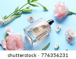 bottle of perfume with flowers... | Shutterstock . vector #776356231