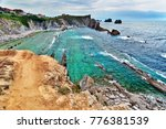 Small photo of Outflow in a stony oсean bay. Turquoise water and unusual stone structures at the bottom, rocky coast