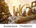 Small photo of holy night on christmas eve son of God, holy infatn Jesus Christ was born in Bethlehem, Joseph and Mary with 3 kings under holy star, christmas tree