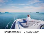 beautiful woman enjoying luxurious yacht cruise, sea travel by luxury boat