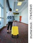 woman dragging luggage boarding ... | Shutterstock . vector #776425645