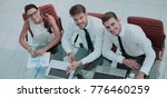 Small photo of Photo of a young business team working in a modern office. Top v