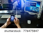 man holding a phone with a... | Shutterstock . vector #776475847